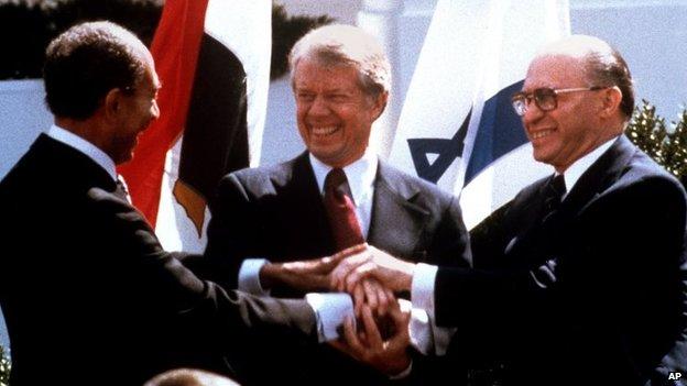 Sadat, Carter and Begin celebrate the Camp David Agreement in 1979