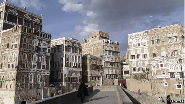 A woman walks on a bridge in the Old Sanaa city, Yemen (January 10, 2014)