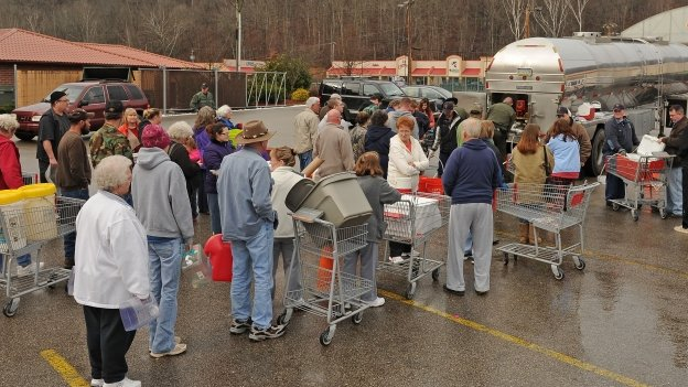 West Virginia State Troopers fill water jugs at the Kmart in Elkview, West Virginia 10 January 2014