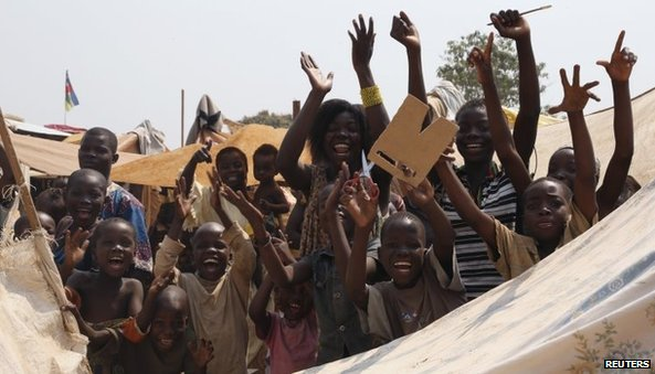 Children celebrate the resignation of interim President Michel Djotodia at Bangui airport camp