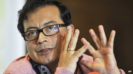 """Bogota""""s Mayor Gustavo Petro speaks to journalists at his office in Bogota, Colombia, Friday, Jan. 10, 2014"""