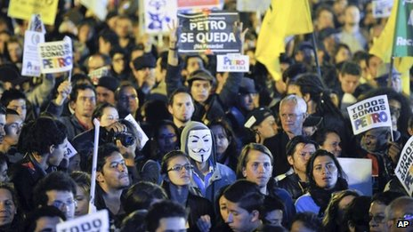 """Supporters of Bogota's Mayor Gustavo Petro hold signs reading in Spanish """"Petro Stays"""" during a rally against Colombia's inspector-general Alejandro Ordonez at the main square in Bogota, Colombia, Friday, Jan. 10, 2014."""