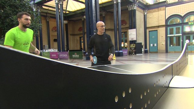 Men playing ping pong
