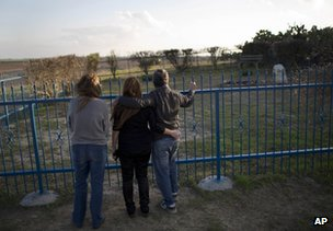 Israelis visit the spot where Sharon is likely to be buried, outside his farm in Havat Hashikmim, southern Israel, 11 January