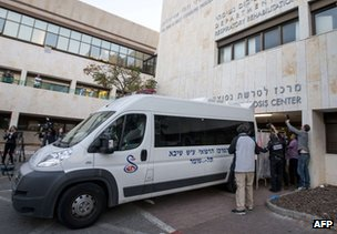 Ariel Sharon's body is loaded into an ambulance at the Tel Hashomer hospital in Tel Aviv, 11 January