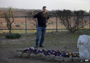 Gilad Sharon visits his mother's grave in Havat Hashikmim, southern Israel, 11 January