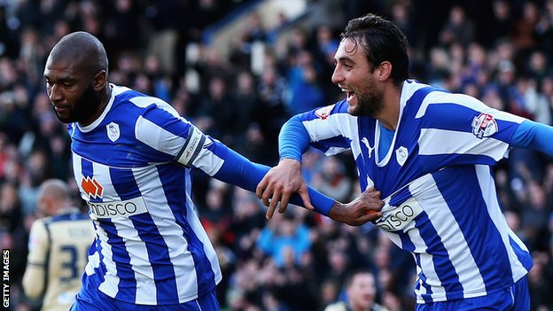 Reda Johnson of Sheffield Wednesday celebrates the opening goal against Leeds