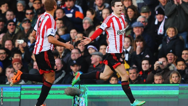 Adam Johnson (right) celebrates scoring for Sunderland