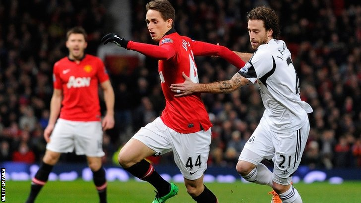 Manchester United's Adnan Januzaj tries to avoid Swansea City's Jose Canas