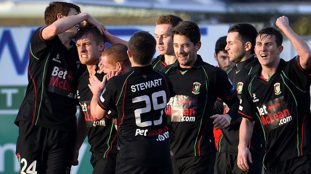Glentoran players celebrate taking the lead against Portadown