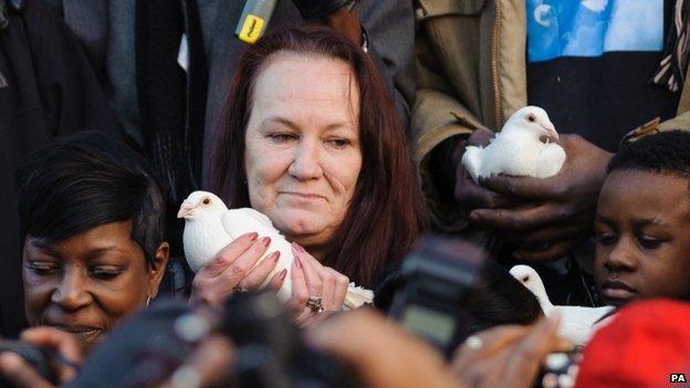 Pamela Duggan, holding a dove