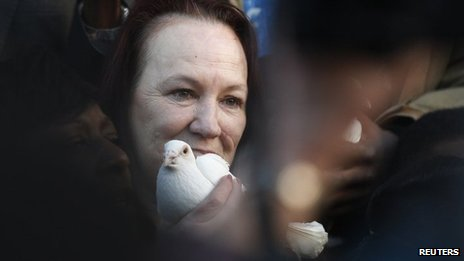 Mr Duggan's mother with a white dove