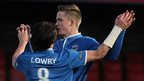 Philip Lowry congratulates Aaron Burns who scored twice for Linfield after being introduced as a substitute
