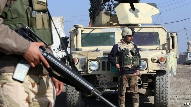 File pic of military checkpoint in Baghdad