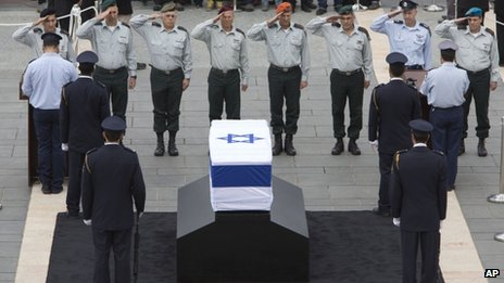 Israeli army generals salute the coffin of former Israeli Prime Minister Ariel Sharon at the Knesset plaza, in Jerusalem, Sunday, Jan. 12, 2014.