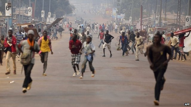 Looters run for cover as they hear rifle shots