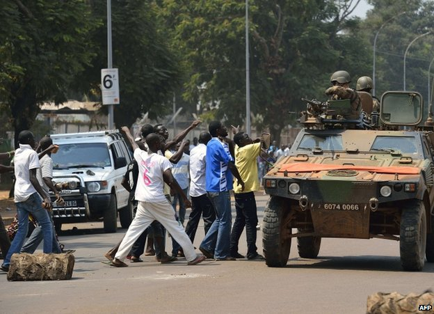 French soldiers try to calm a mob attacking a car in Bangui, 12 January