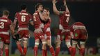 The Scarlets celebrate a famous win in Paris where they beat Racing Metro 19-13 in the Heineken Cup