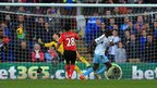 West Ham striker Carlton Cole wheels away after scoring the opening goal against Cardiff