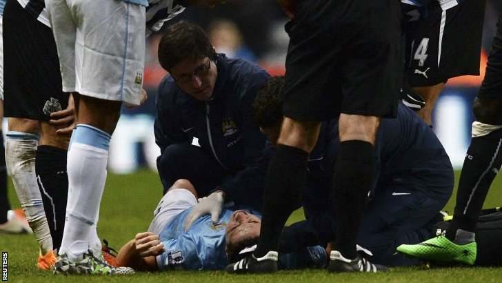 Manchester City's Samir Nasri receives treatment