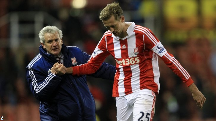 Stoke City boss Mark Hughes and goalscorer Peter Crouch