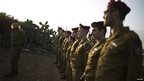 Soldiers from a paratroopers' unit once commanded by Ariel Sharon rehearsed an honour guard at the farm ahead of Monday's burial ceremony