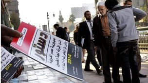 Egyptian vender sells copies of new constitution in Cairo (December 2013)