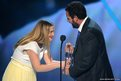 Actor Adam Sandler accepts the Favorite Comedic Movie Actor award from actress Drew Barrymore
