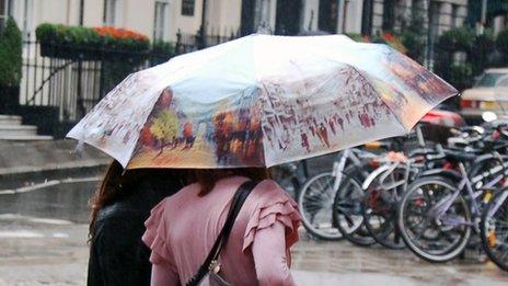 People under umbrellas