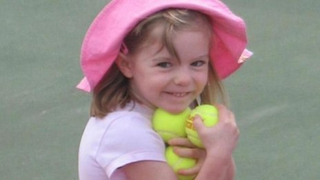 Madeleine McCann, holding several tennis balls, shortly before her disappearance