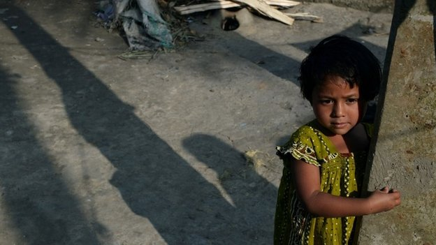 The last polio patient registered in India, three year-old Rukhshar Khatoon looks on outside her home in West Bengal
