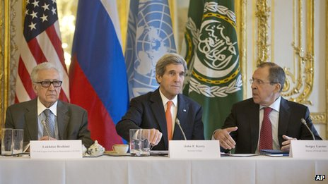 US Secretary of State John Kerry (C). Russian Foreign Minister Sergei Lavrov (R) and UN-Arab League envoy for Syria Lakhdar Brahimi in Paris