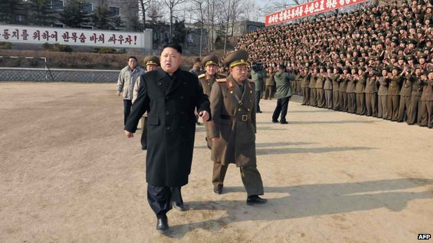 This undated picture released from North Korea's official Korean Central News Agency (KCNA) on 12 January 2014 shows North Korean leader Kim Jong-Un (front L) inspecting the command of Korean People's Army (KPA) Unit 534