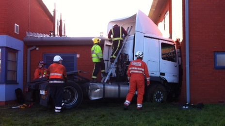 Firefighters attend to lorry tractor unit