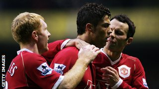 Ronaldo celebrates with Ryan Giggs (right) and Paul Scholes (left).