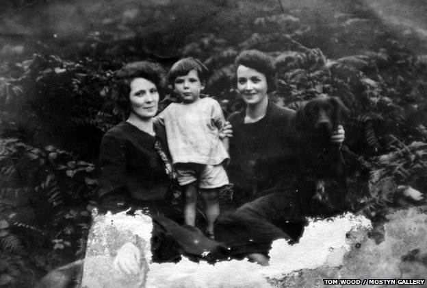 Two women, a child and a dog