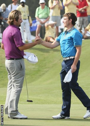 Tommy Fleetwood of England (right) and Victor Dubuisson of France during the final round of the 2014 Volvo Golf Champions at Durban Country Club on January 12, 2014 in Durban.