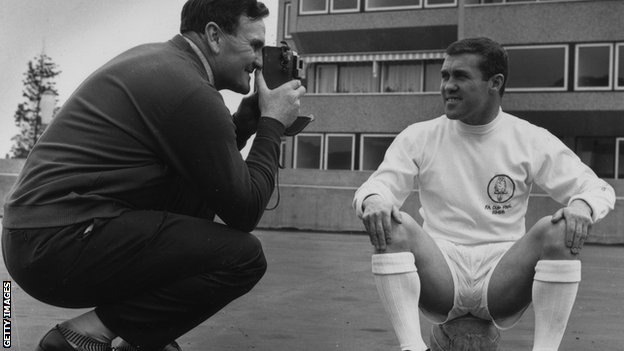 Leeds manager Don Revie takes a picture of new signing Bobby Collins