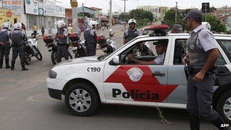 Policemen outside Vida Nova bus station in Campinas