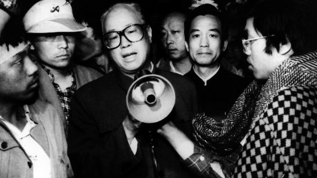 In this 19 May 1989 file photo, Communist Party General Secretary Zhao Ziyang, centre with megaphone, speaks with fasting university students in Beijing's Tiananmen Square, the last time he was seen in public