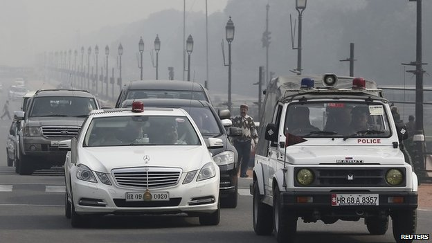 A government vehicle with a red light atop is driven along a road in New Delhi January 8, 2014.