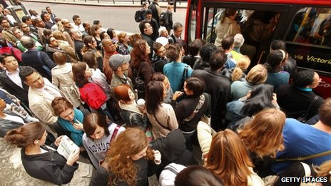 Commuters crowd a bus during a Tube strike