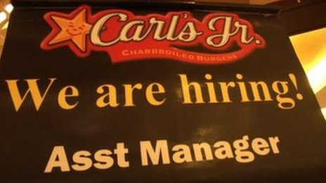 A sign outside Carl's Jr in Malaysia