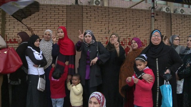 A queue of women waiting to vote