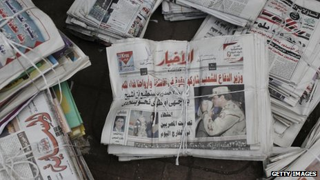 An Egyptian newspaper shows a picture of Defence Minister General Abdul Fattah al-Sisi near a polling booth in the district of Zamalek on January 14, 2014 in Cairo, Egypt.