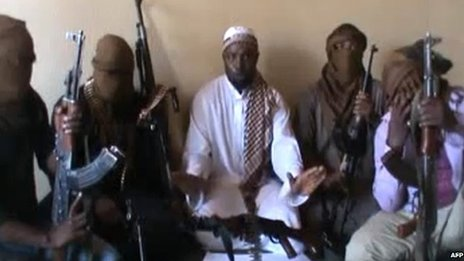 A screen grab allegedly showing Boko Haram leader Abubakar Shekau (C)  flanked by militants