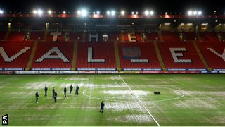 The Valley's rain-soaked pitch