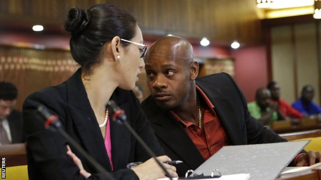 Asafa Powell with attorney Danielle Chai at his hearing