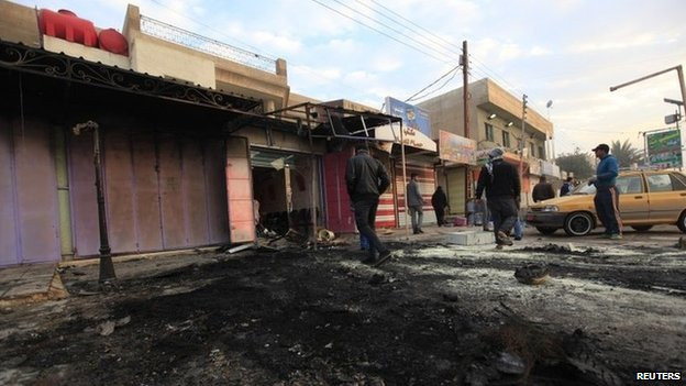 Aftermath of bomb attack in Baghdad's Ghazaliya district (15 January 2014)