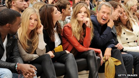 Mario Testino in the front row at Burberry fashion show